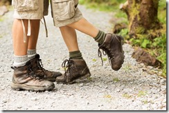 Female Hiker Standing On Toe With Man